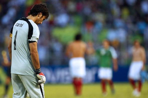 Uruguay's goalkeeper Fabian Carini react