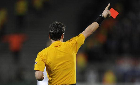 Swiss referee Massimo Busacca shows Olym