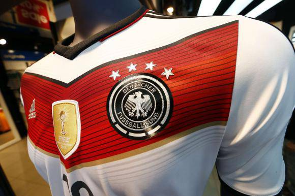 A memorabilia jersey of German national soccer team showing four stars, symbolizing the number of reached World Cup championships, is seen in Frankfurt