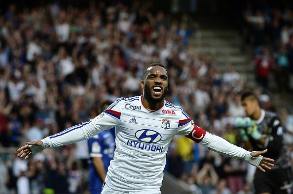 Lyon's French forward Alexandre Lacazette celebrates after scoring a goal during the French L1 football match Olympique Lyonnais (OL) vs SC Bastia (SCB) on April 15, 2015, at the Gerland Stadium in Lyon, central-eastern France. AFP PHOTO / JEFF PACHOUD        (Photo credit should read JEFF PACHOUD/AFP/Getty Images)