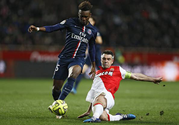 Monaco's French midfielder Jeremy Toulalan (R) fights for the ball with Paris Saint-Germain's French forward Jean-Christophe Bahebeck during the French L1 football match Monaco (ASM) vs Paris Saint-Germain (PSG), on March 1, 2015 at Louis II stadium in Monaco.  AFP PHOTO / VALERY HACHE        (Photo credit should read VALERY HACHE/AFP/Getty Images)