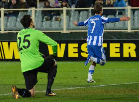 Esbjerg's forward Mikkel Vestergaard (R) celebrates after scoring a goal as Fiorentina's goalkeeper Antonio Rosati (L) reacts during the round of 32 UEFA Europa League football match between Fiorentina and Esbjerg at the Artemio Franchi stadium in Florence on February 27, 2014. AFP PHOTO / VINCENZO PINTO        (Photo credit should read VINCENZO PINTO/AFP/Getty Images)