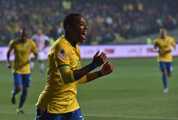 Brazil's forward Robinho celebrates after scoring against Paraguay during their 2015 Copa America football championship quarter-final match, in Concepcion, Chile, on June 27, 2015.   AFP PHOTO / NELSON ALMEIDA        (Photo credit should read NELSON ALMEIDA/AFP/Getty Images)