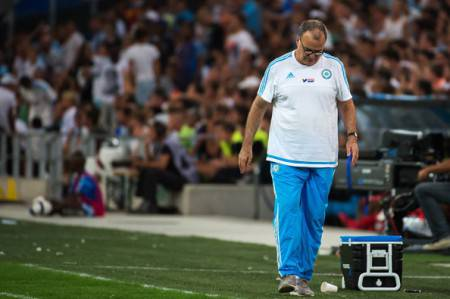 "Marseille's Argentinian head coach Marcelo Bielsa looks down during the French L1 football match between Olympique de Marseille and Stade Malherbe de Caen on August 8, 2015 at the Velodrome stadium in Marseille, southern France. Marcelo Bielsa stunned French football on August 8 when he quit as coach of Marseille just minutes after his team had lost their season opener 1-0 at Caen. ""I have resigned from my post as manager of Marseille,"" the Argentine announced at the end of his post-match news conference. AFP PHOTO / BERTRAND LANGLOIS        (Photo credit should read BERTRAND LANGLOIS/AFP/Getty Images)"