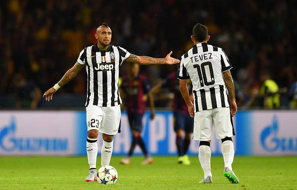 BERLIN, GERMANY - JUNE 06: Arturo Vidal and Carlos Tevez of Juventus react after the second Barcelona goal by Luis Suarez during the UEFA Champions League Final between Juventus and FC Barcelona at Olympiastadion on June 6, 2015 in Berlin, Germany. (Photo by Shaun Botterill/Getty Images)