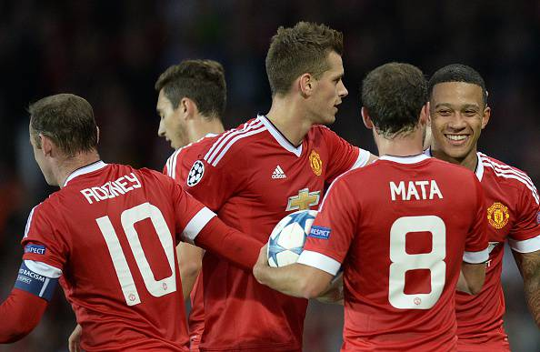Manchester United's Dutch midfielder Memphis Depay (R) is congratulated after scoring his team's second goal during the UEFA Champions League play off football match between Manchester United and Club Brugge at Old Trafford in Manchester, north west England, on August 18, 2015. AFP PHOTO / OLI SCARFF        (Photo credit should read OLI SCARFF/AFP/Getty Images)