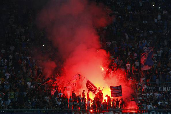 Napoli's fans burn flares before the Italian Serie A football match SSC Napoli vs UC Sampdoria on August 30, 2015 at the San Paolo stadium in Naples. AFP PHOTO / CARLO HERMANN (Photo credit should read CARLO HERMANN/AFP/Getty Images)