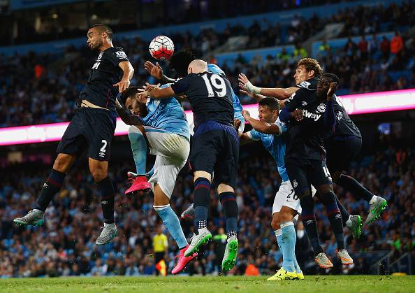 MANCHESTER, ENGLAND - SEPTEMBER 19:  Winston Reid of West Ham United (L) goes up for the ball during the Barclays Premier League match between Manchester City and West Ham United at Etihad Stadium on September 19, 2015 in Manchester, United Kingdom.  (Photo by Dean Mouhtaropoulos/Getty Images)