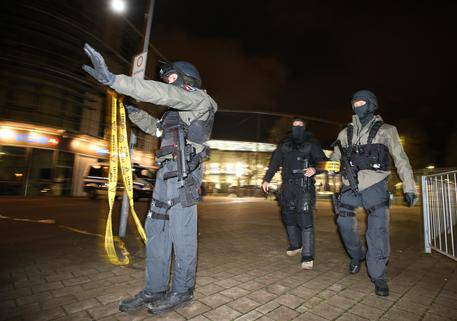 Special police forces cordon off the stadium in Hannover, Germany, Tuesday, Nov. 17, 2015 after the soccer friendly match between Germany and the Netherlands was cancelled due to a bomb threat. (Christian Charisius/dpa via AP)