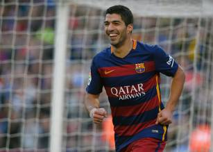 Barcelona's Uruguayan forward Luis Suarez celebrates after scoring his team's second goal during the Spanish league football match FC Barcelona vs Real Sociedad de Futbol at the Camp Nou stadium in Barcelona on November 28, 2015.   AFP PHOTO/ LLUIS GENE / AFP / LLUIS GENE        (Photo credit should read LLUIS GENE/AFP/Getty Images)