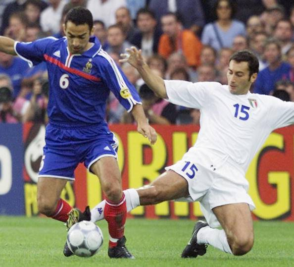 French midfielder Youri Djorkaeff (L) tries to avo
