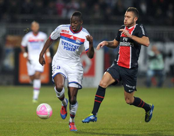 Lyon's French defender Aly Cissokho (L)