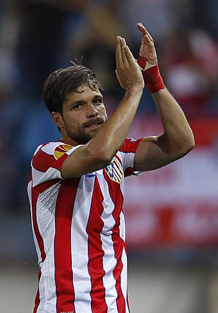 Atletico Madrid's Diego celebrates after scoring a goal against Celtic during their Europa League Group I soccer match in Madrid