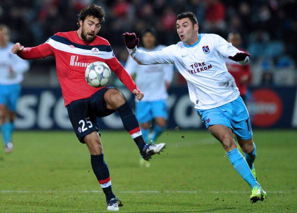 Trabzonspor's midfielder Burak Yilmaz (R